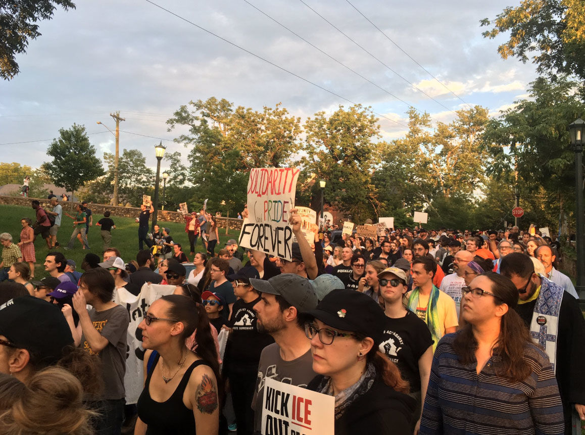 "Protesters shout, ""All these cops have got to go,"" suring a student-led rally against the University of Virginia's response during last year's deadly white nationalist rally. (WTOP/Max Smith)"