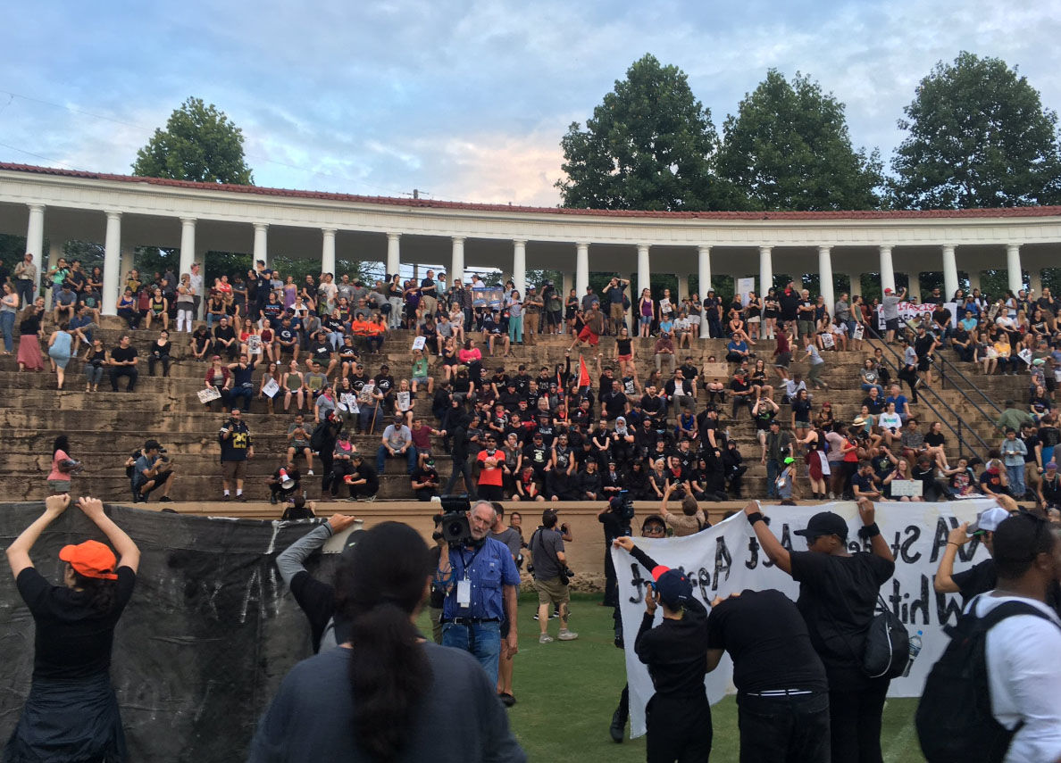 A student-led protest descends at Lambeth. The protesters are addressing the increased police presence at the University of Virginia that was brought in for the one-year mark of the deadly white nationalist rally. (WTOP/Max Smith)