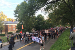 Part of the student-led protest at the University if Virginia in Charlottesville veers from the permit area on Saturday, Aug. 11, 2018. (WTOP/Max Smith)