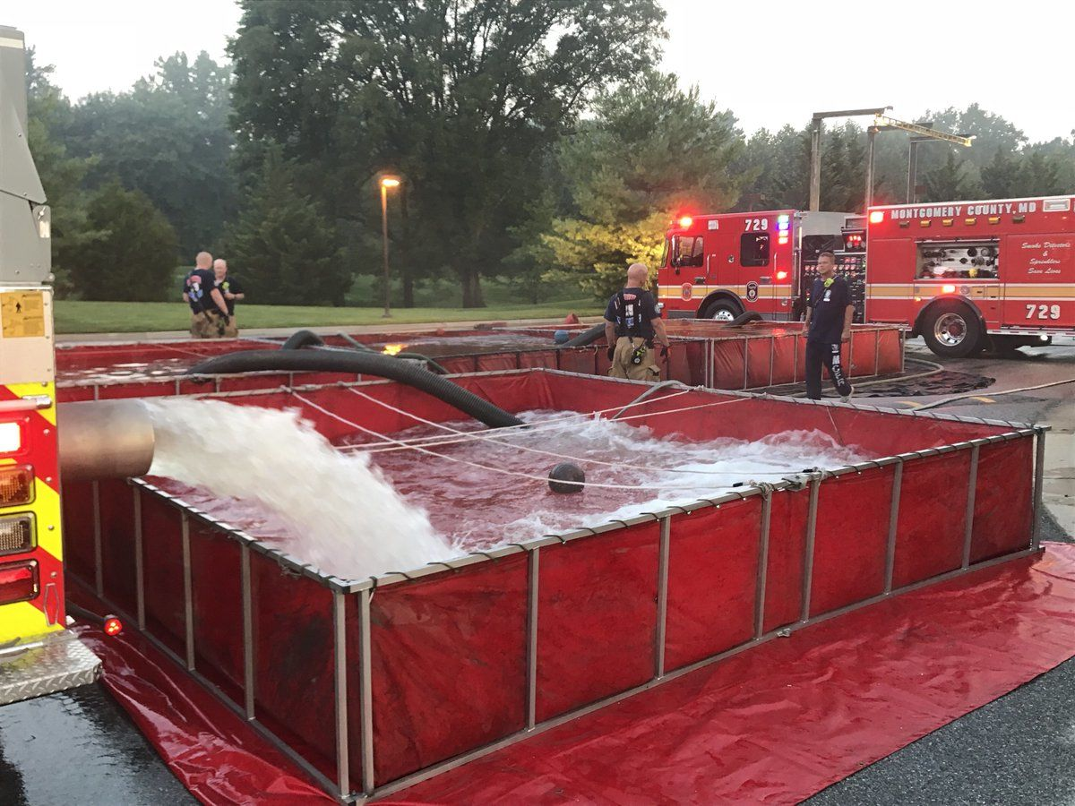 Firefighters are using pools of water to fight the blaze. (Courtesy Daniel Ogren/Montgomery County Fire)