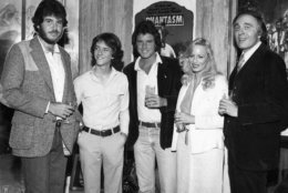 "The cast and crew of ""Phantasm"" toast its success. From left to right: Don Coscarelli, Michael Baldwin, Bill Thornbury, Kathy Lester and Angus Scrimm. (Courtesy Silver Sphere Productions)"