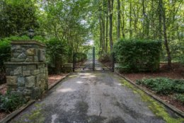 The front security gate at Tom Clancy's Peregrine Cliff estate. (Courtesy Cummings & Co. Realtors)