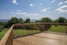 A view of the woods and the Chesapeake Bay from one of the decks at Tom Clancy's estate. (Courtesy Cummings & Co. Realtors)