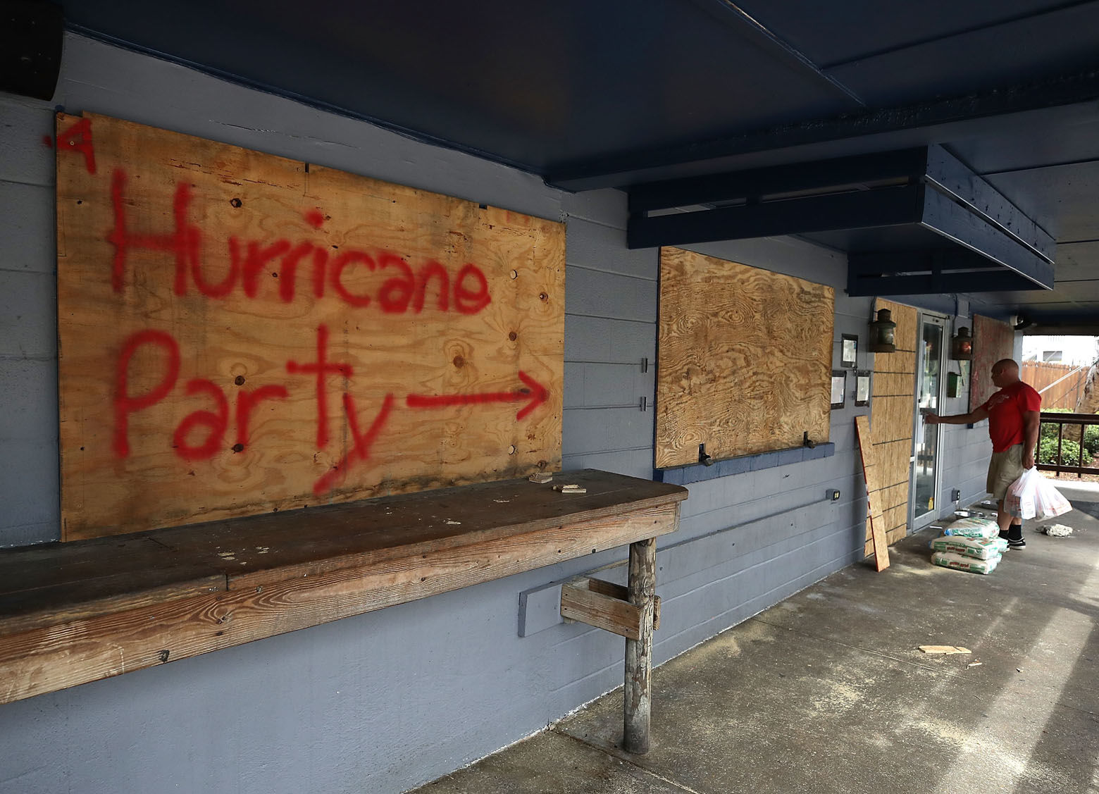 WRIGHTSVILLE BEACH, NC- SEPTEMBER 11: Hurricane Party is written on plywood covering the window of the Lager Heads Tavern as they prepare for the arrival of Hurricane Florence on September 11, 2018 in Wrightsville Beach, United States. Hurricane Florence is expected on Friday possibly as a category 4 storm along the Virginia, North Carolina and South Carolina coastline.  (Photo by Mark Wilson/Getty Images)