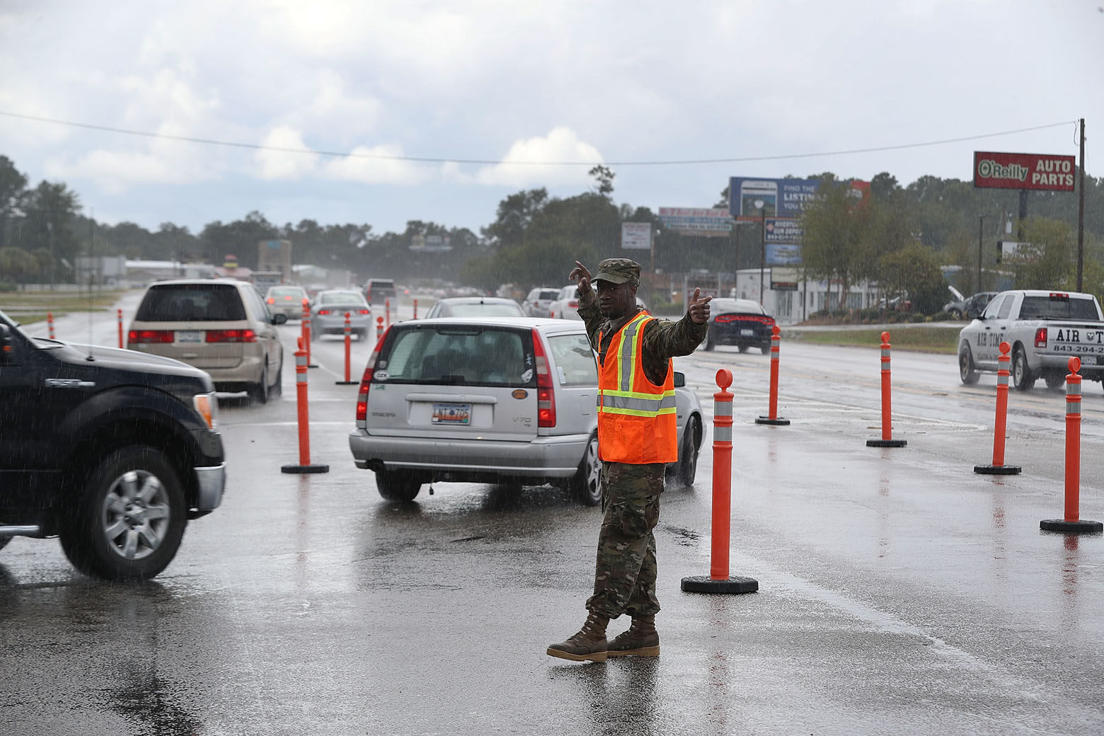 MYRTLE BEACH, SC - SEPTEMBER 11:  PFC. Traequan Shaw of the  South Carolina National Guard directs traffic onto US 501 as the South Carolina government ordered that traffic use all the lanes on the route leading away from the coast to facilitate the evacuation of people ahead of the arrival of Hurricane Florence on September 11, 2018 in Myrtle Beach, United States. Hurricane Florence is expected to arrive on Friday, possibly as a category 4 storm along the Virginia, North Carolina and South Carolina coastline.  (Photo by Joe Raedle/Getty Images)