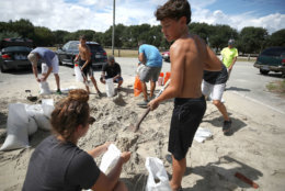 WRIGHTSVILLE BEACH, NC- SEPTEMBER 11: Local resident Dave Collins shovels sand into a bag while the coastal area is preparing for the arrival of Hurricane Florence on September 11, 2018 in Wrightsville Beach, United States. Hurricane Florence is expected on Friday possibly as a category 4 storm along the Virginia, North Carolina and South Carolina coastline.  (Photo by Mark Wilson/Getty Images)