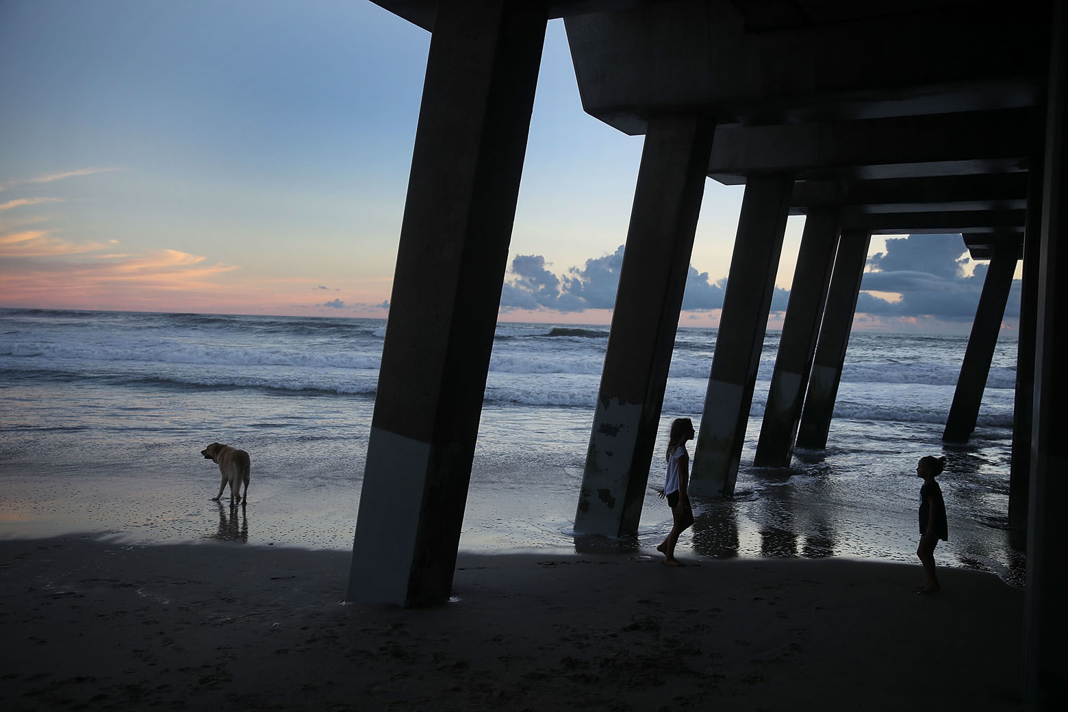 NAGS HEAD, NC - SEPTEMBER 12:  Charlotte Miller and Lilly Miller (L-R) visit the beach ahead of the arrival of Hurricane Florence on September 12, 2018 in Nags Head, North Carolina. Hurricane Florence is expected on Friday possibly as a category 4 storm along the Virginia, North Carolina and South Carolina coastline.  (Photo by Joe Raedle/Getty Images)