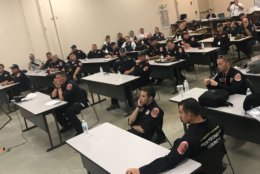 MD Task Force 1 gets final briefing before deploying to South Carolina ahead of Hurricane Florence. (WTOP/Neal Augenstein)
