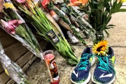 Flowers are left near the carryout where Wendy Martinez went for help after being stabbed.  (WTOP/Neal Augenstein)