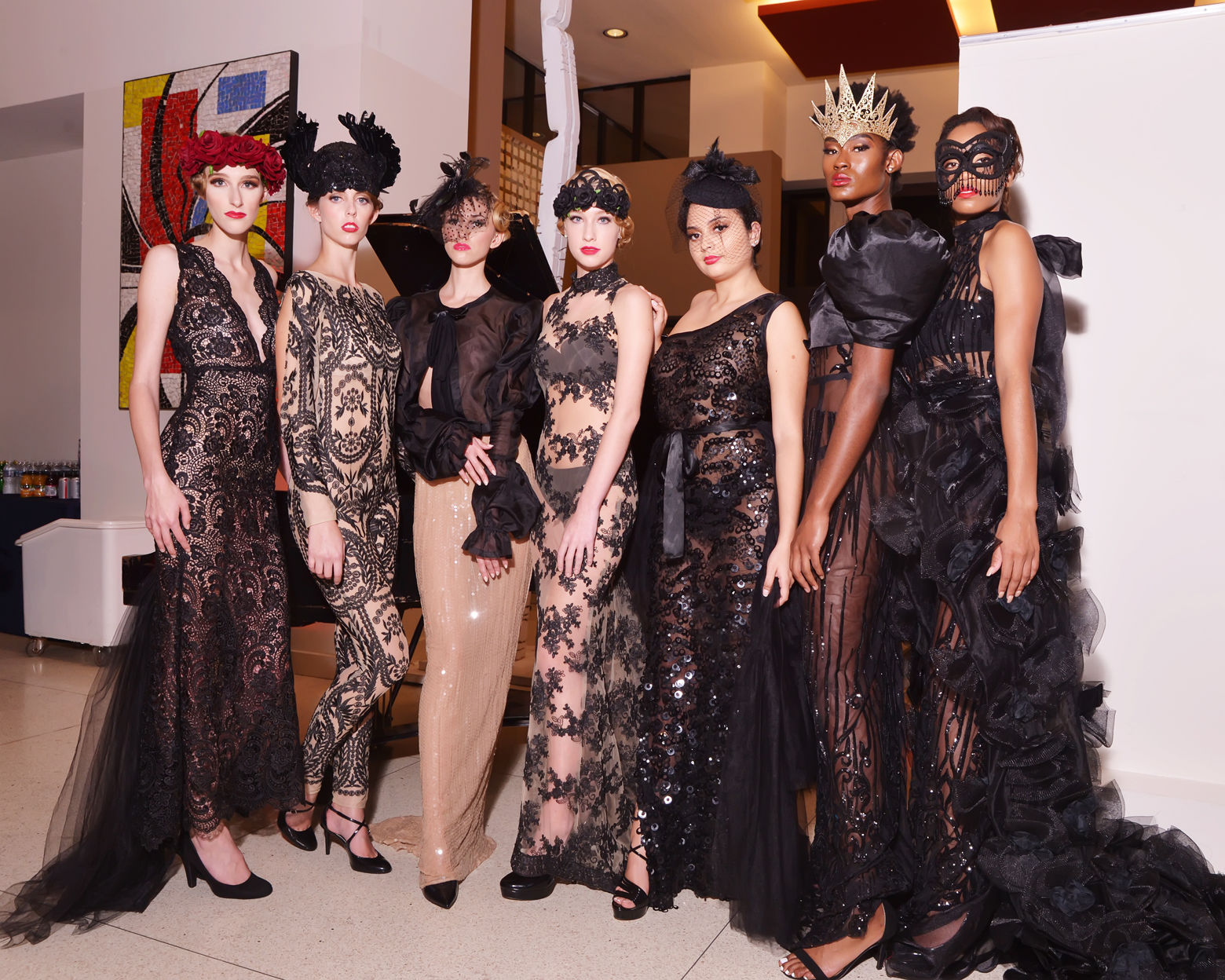 Models pose in dresses by Washington, DC-based designer Ean Williams following the runway show at DC Fashion Week's 2018 International Couture Collections at the Embassy of France. (Shannon Finney Photography)