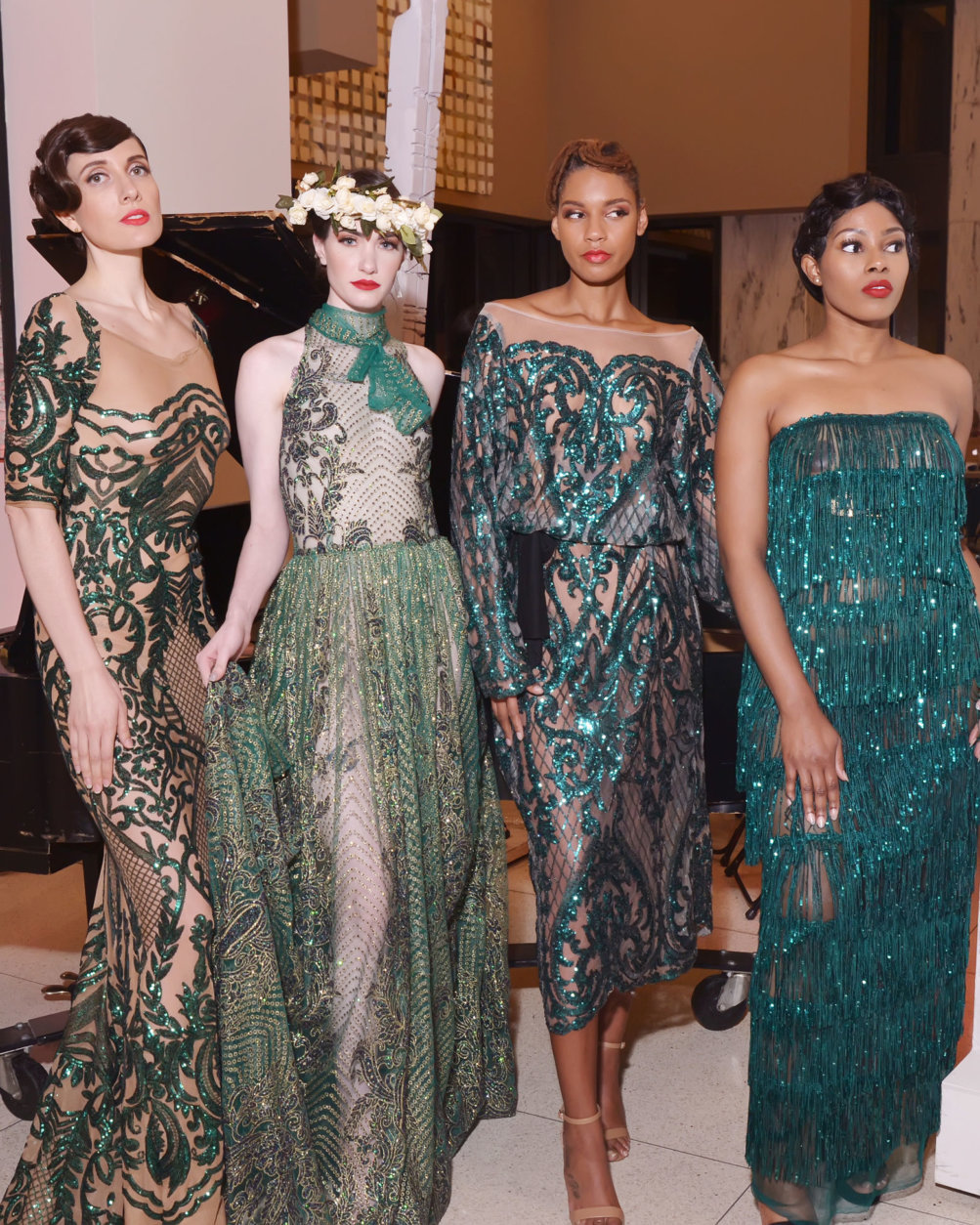 Models pose in dresses by Washington, DC-based designer Ean Williams following the runway show at DC Fashion Week's 2018 International Couture Collections at the Embassy of France