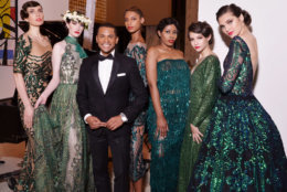 Models pose with host Guy Lambert of WPGC radio following the runway show at DC Fashion Week's 2018 International Couture Collections at the Embassy of France