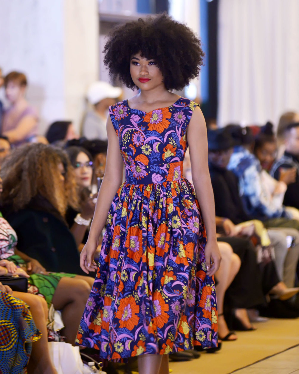 A model wearing an outfit by Washington, DC-based ModCloth walks the runway at DC Fashion Week's 2018 International Couture Collections at the Embassy of France