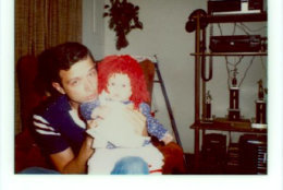 Virginia State Trooper Johnny Rush Bowman with daughter Nikki on his knee. (Courtesy FBI)
