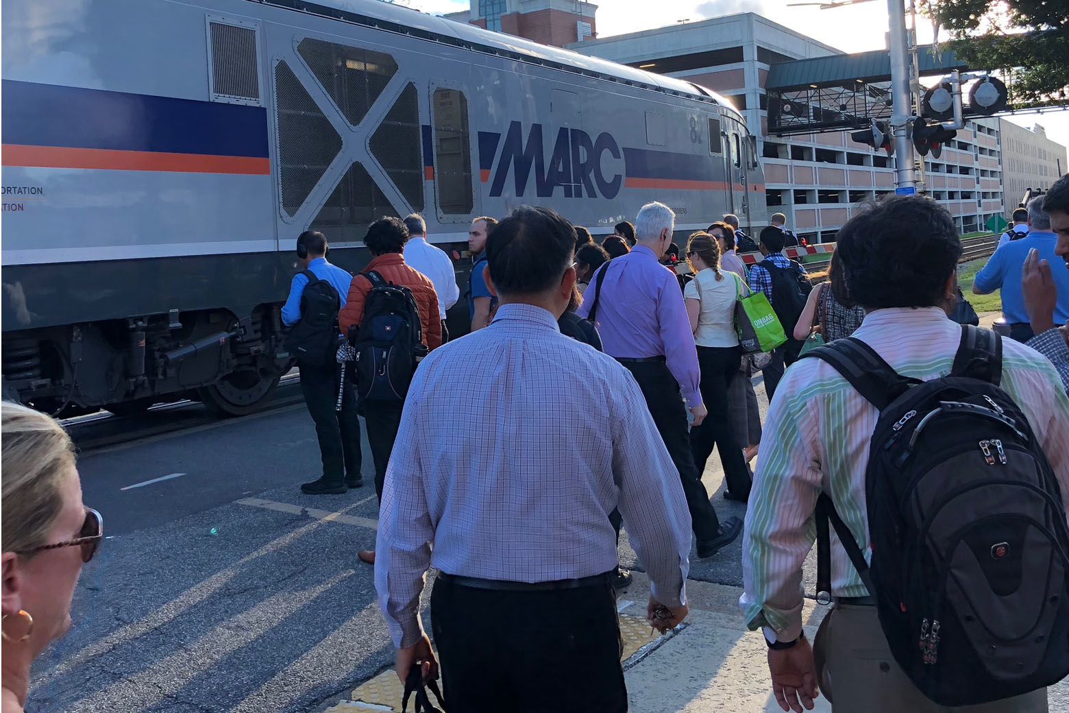 In this WTOP photo, commuters in Old Town Gaithersburg wait to board a MARC train on a recent morning. The D.C. region's traffic problems are well-documented, and in Montgomery County, residents complain about gridlock while debating how best to alleviate it. (WTOP/Kate Ryan)