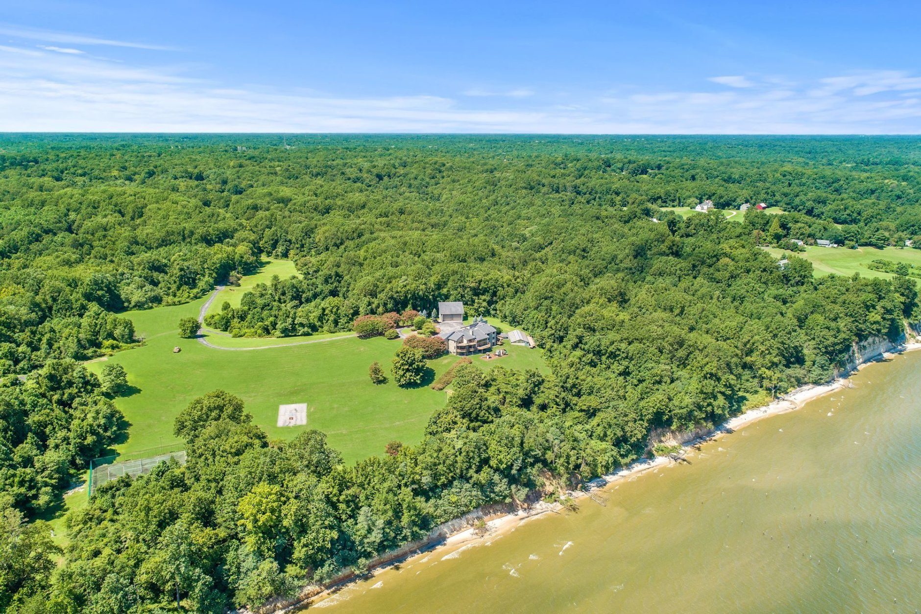 Peregrine Cliff is surrounded by lush trees. (Courtesy Cummings & Co. Realtors)
