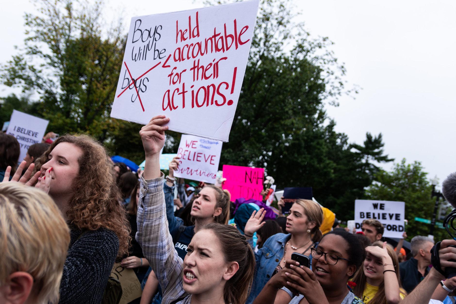 Women demonstrate in support of Christine Blasey Ford outside of the Supreme Court in D.C. on Thursday, September 28, 2018. (WTOP/Alejandro Alvarez)