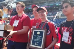 """""""It's Academic"""" winners honored with a plaque. (WTOP/Hillary Howard)"""