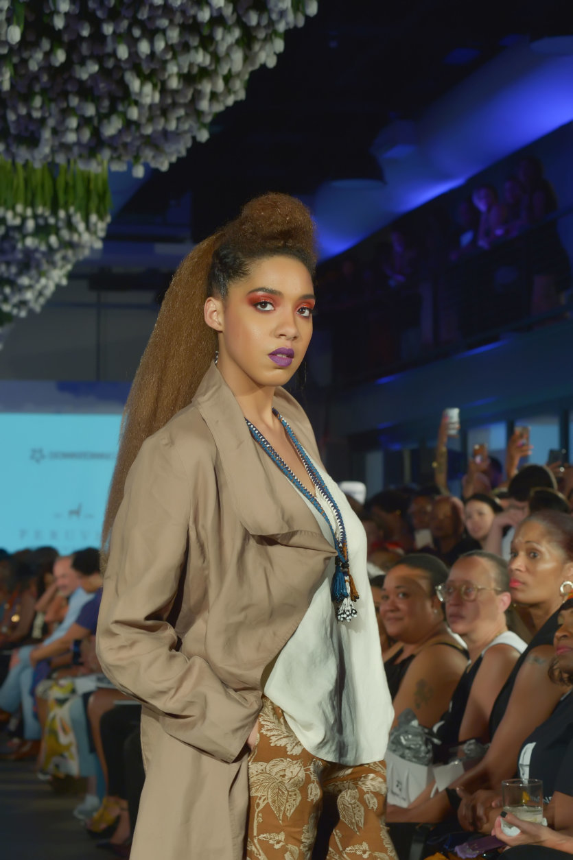 """A model wears pieces from the Peruvian Connection at the District of Fashion Runway Show hosted by the DowntownDC Business Improvement District (BID). (Courtesy Shannon Finney/<a href=""""https://www.shannonfinneyphotography.com/index"""" target=""""_blank"""" rel=""""noopener noreferrer"""">shannonfinneyphotography.com</a>)"""