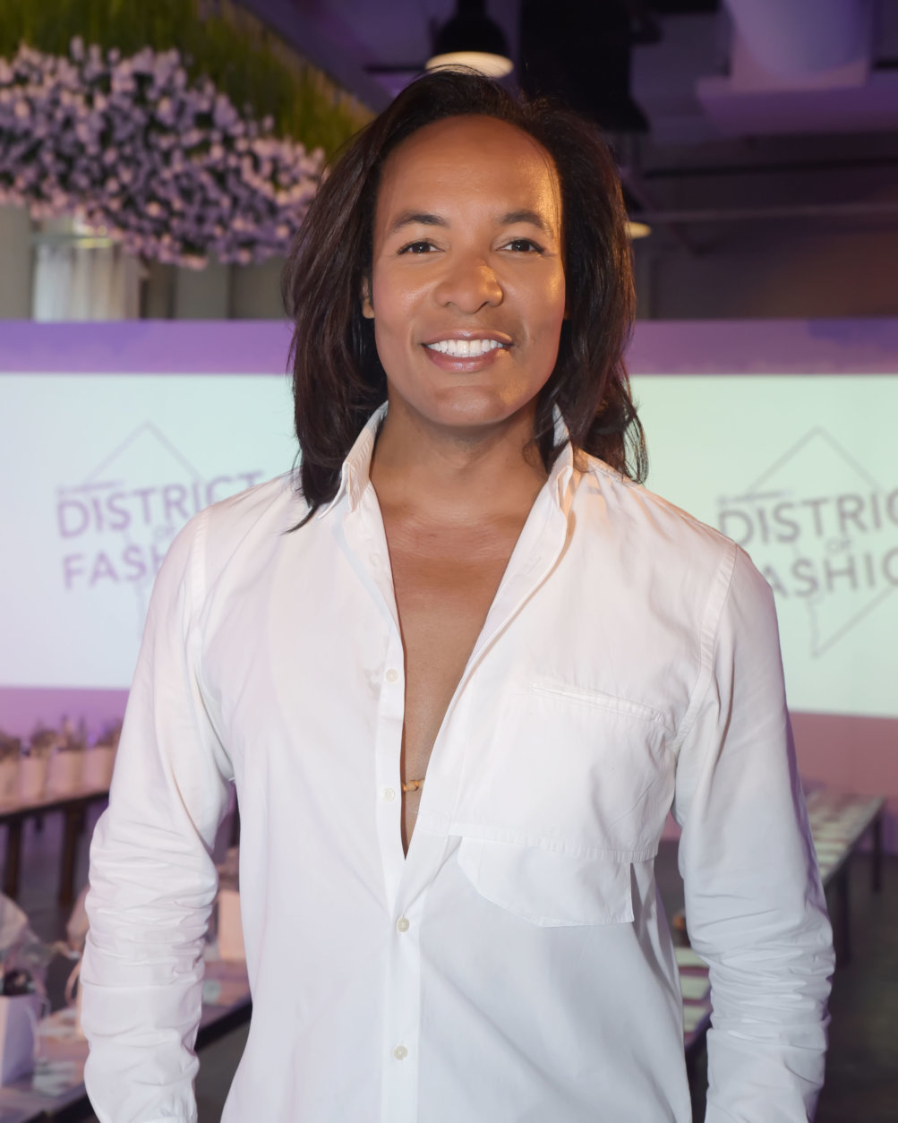 "Television personality, stylist, and author Paul Wharton hosts the District of Fashion runway show. (Courtesy Shannon Finney/<a href=""https://www.shannonfinneyphotography.com/index"" target=""_blank"" rel=""noopener noreferrer"">shannonfinneyphotography.com</a>)"