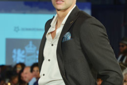 """A model wears pieces from Christopher Schafer Clothier on the runway at the District of Fashion hosted by the the DowntownDC Business Improvement District (BID). (Courtesy Shannon Finney/<a href=""""https://www.shannonfinneyphotography.com/index"""" target=""""_blank"""" rel=""""noopener noreferrer"""">shannonfinneyphotography.com</a>)"""