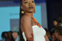 """A model wears jewelry pieces from Carmen Eliam Jewelry at the District of Fashion runway show hosted by the DowntownDC Business Improvement District (BID). (Courtesy Shannon Finney/<a href=""""https://www.shannonfinneyphotography.com/index"""" target=""""_blank"""" rel=""""noopener noreferrer"""">shannonfinneyphotography.com</a>)"""