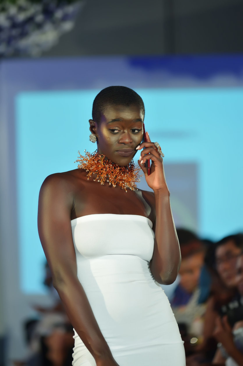 "A model wears jewelry pieces from Carmen Eliam Jewelry at the District of Fashion runway show hosted by the DowntownDC Business Improvement District (BID). (Courtesy Shannon Finney/<a href=""https://www.shannonfinneyphotography.com/index"" target=""_blank"" rel=""noopener noreferrer"">shannonfinneyphotography.com</a>)"