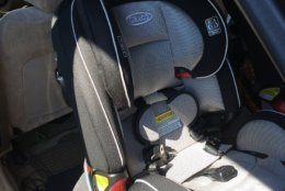 To make sure parents get the right information and keep children safe, law enforcement and safety advocates showed parents how toproperly install car seats and answered common questions. (WTOP/Liz Anderson)