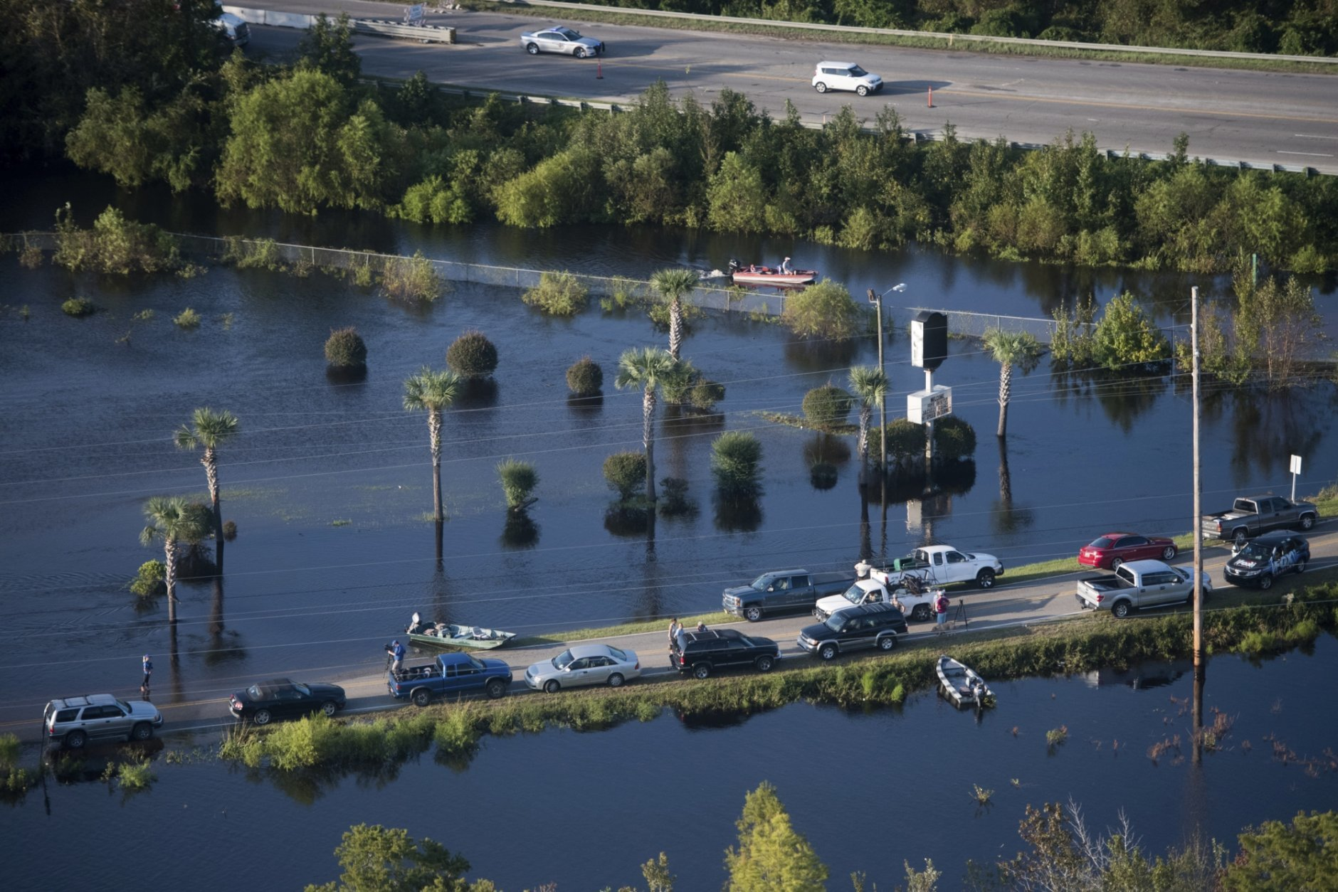 People use a road as a boat ramp after Hurricane Florence struck the Carolinas Monday, Sept. 17, 2018, in Conway, S.C. Many rivers in the Carolinas are approaching record flood stages and their levels will continue to rise through the week. (AP Photo/Sean Rayford)