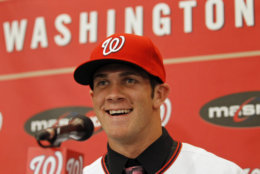 Bryce Harper, smiles, at a news conference where the Washington Nationals basetball team introduced him as their first overall selection in the 2010 First-Year Player Draft, at Nationals Park in Washington Thursday, Aug. 26, 2010.(AP Photo/Alex Brandon)