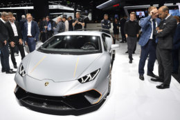 Visitors look at a Lamborghini Huracan Performante on the first media day of the International Frankfurt Motor Show IAA in Frankfurt, Germany, Tuesday, Sept. 12, 2017, which runs through Sept. 24, 2017. (AP Photo/Martin Meissner)