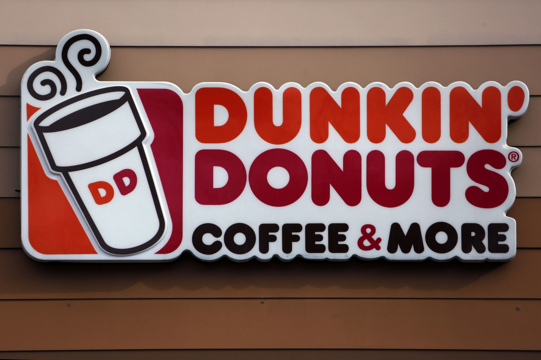 Dunkin' is serving up a new name and a free coffee on National Coffee Day: if you buy one hot coffee, you can get another hot coffee for free. (AP/Gene J. Puskar)
