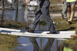 President George W. Bush tours an area damaged by Hurricane Ivan Sunday, Sept. 19, 2004 in Pensacola, Fla. (AP Photo/Charles Dharapak)