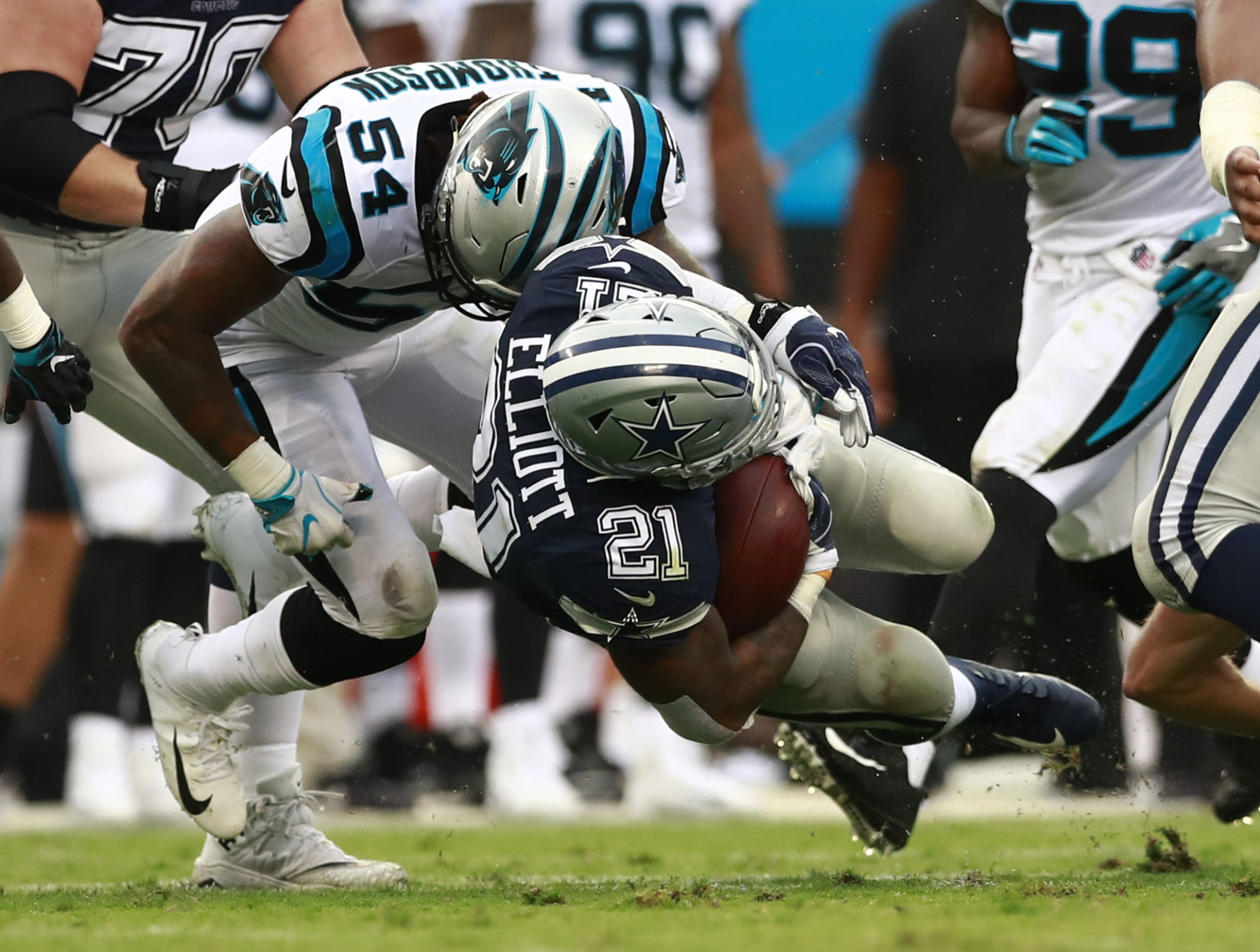 Carolina Panthers' Shaq Green-Thompson (54) tackles Dallas Cowboys' Ezekiel Elliott (21) during the second half of an NFL football game in Charlotte, N.C., Sunday, Sept. 9, 2018. (AP Photo/Jason E. Miczek)
