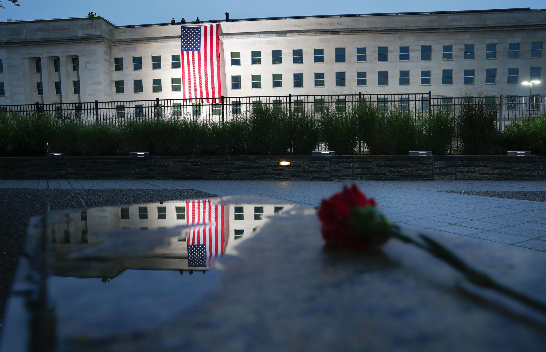 A U.S. flag is unfurled at sunrise on Tuesday, Sept. 11, 2018, at the Pentagon on the 17th anniversary of the Sept. 11, 2001, terrorist attacks. (AP Photo/Pablo Martinez Monsivais)