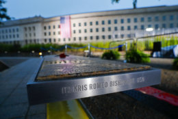 The National 9/11 Pentagon Memorial is seen in the foreground after the U.S. flag is unfurled Tuesday, Sept. 11, 2018, at the Pentagon on the 17th anniversary of the Sept. 11, 2001, terrorist attacks. (AP Photo/Pablo Martinez Monsivais)