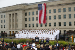 Vice President Mike Pence, center, speaks during the September 11th Pentagon Memorial Observance at the Pentagon on the 17th anniversary of the September 11th attacks, Tuesday, Sept. 11, 2018. Also on stage is Defense Secretary Jame Mattis and Joint Chiefs Chairman Gen. Joseph Dunford. Tuesday, Sept. 11, 2018. (AP Photo/Pablo Martinez Monsivais)