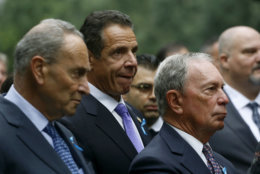 Attending a ceremony marking the 17th anniversary of the terrorist attacks on the United States are, left to right: U.S. Senator Chuck Schumer, D-NY, New York Gov. Andrew Cuomo, and former New York Mayor Michael Bloomberg, Tuesday, Sept. 11, 2018, in New York. (AP Photo/Mark Lennihan)