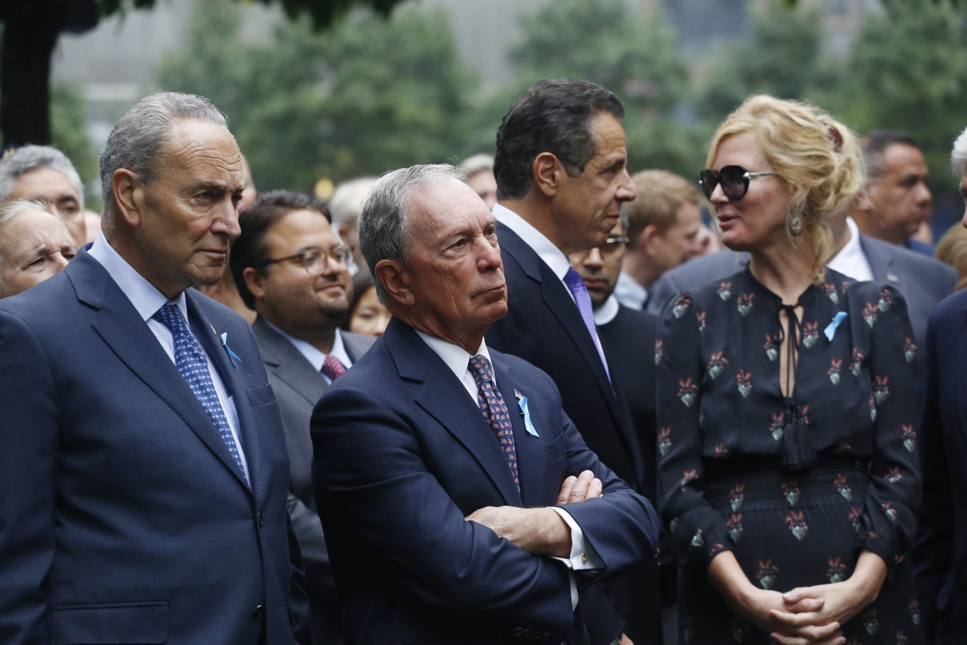 From left, U.S. Senator Chuck Schumer, D-NY, former New York Mayor Michael Bloomberg, New York Gov. Andrew Cuomo and his girlfriend, TV chef Sandra Lee, attend the ceremony marking the 17th anniversary of the terrorist attacks on the United States, Tuesday, Sept. 11, 2018, in New York.  (AP Photo/Mark Lennihan)