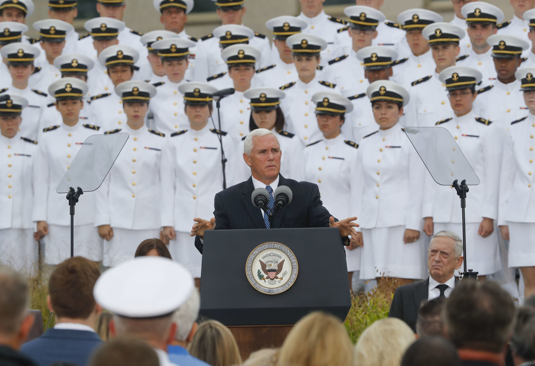 Vice President Mike Pence, center, speaks during the September 11th Pentagon Memorial Observance at the Pentagon on the 17th anniversary of the September 11th attacks, Tuesday, Sept. 11, 2018. Also on stage is Defense Secretary Jame Mattis, right. (AP Photo/Pablo Martinez Monsivais)