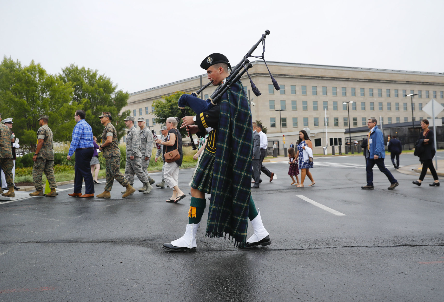 A musician plays his bagpipes as he walks with visitors and guests before the start of the September 11th Pentagon Memorial Observance at the Pentagon on the 17th anniversary of the September 11th attacks, Tuesday, Sept. 11, 2018. (AP Photo/Pablo Martinez Monsivais)