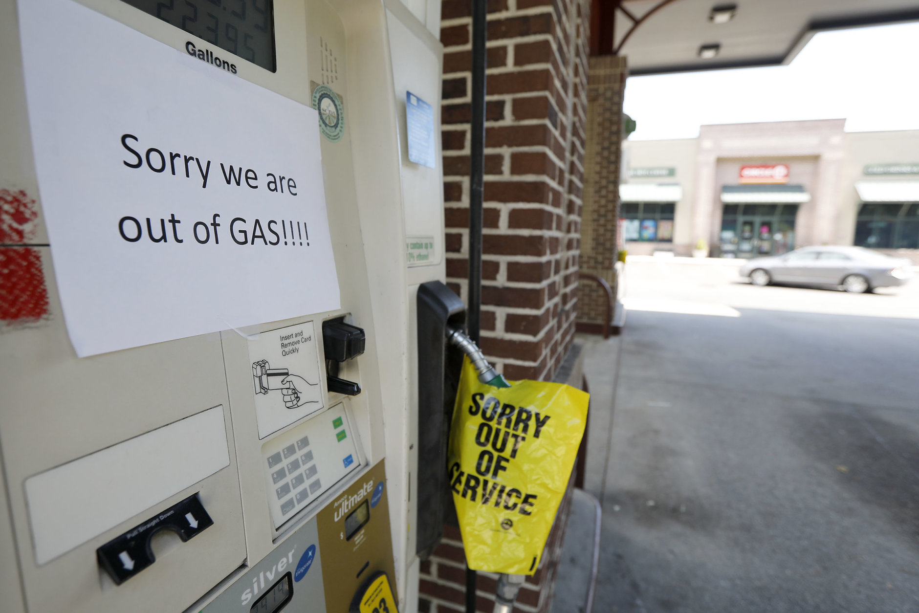 A gas station in Mt. Pleasant S.C. alerts motorist that it is out of gas due to the heavy demand caused by Hurricane Florence Tuesday, Sept. 11, 2018. (AP Photo/Mic Smith)