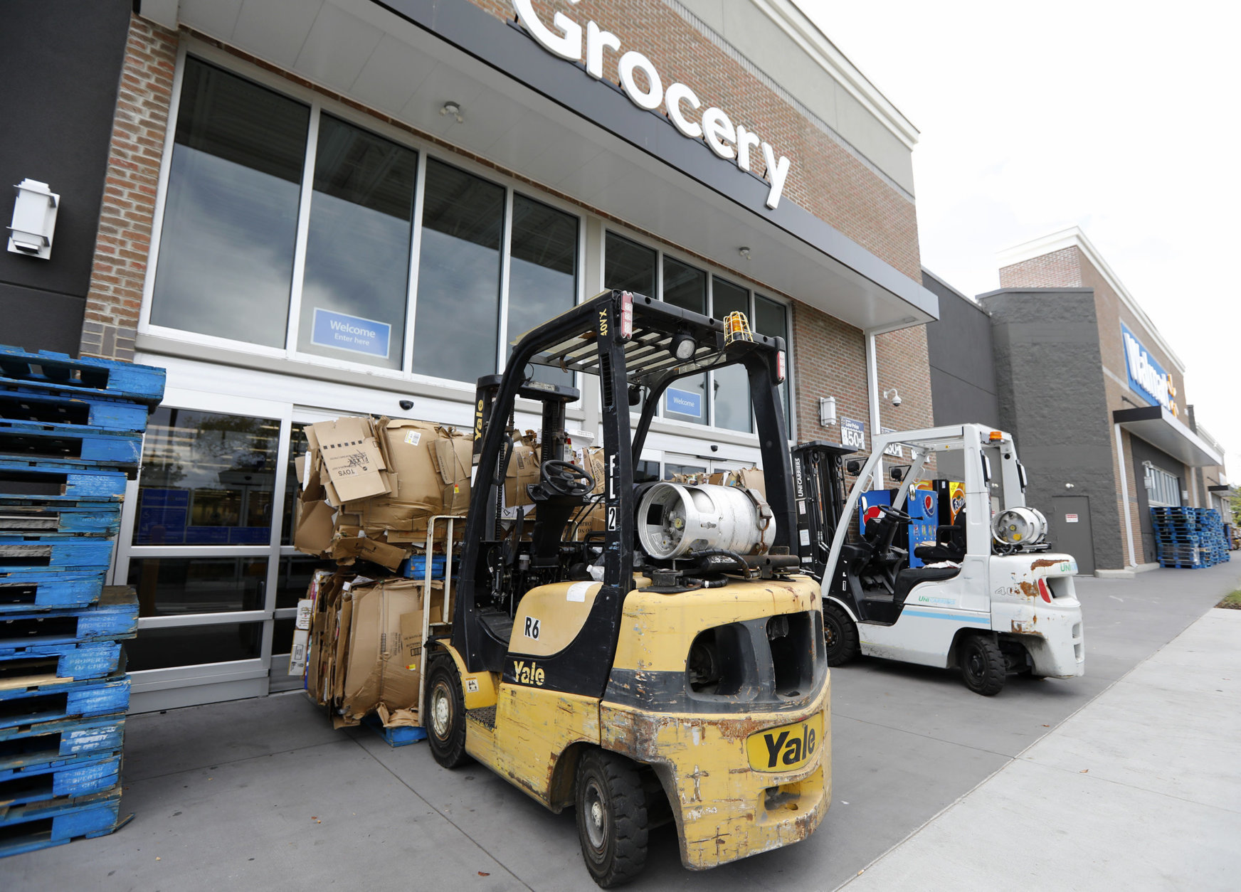 A Walmart in Mt. Pleasant, S.C, is closed, and barricaded, after Gov. Henry McMaster ordered a mandatory evacuation due to Hurricane Florence Tuesday, Sept. 11, 2018. (AP Photo/Mic Smith)