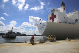 Sailors cast off mooring lines to the Military Sealift Command hospital ship USNS Comfort (T-AH 20) Tuesday, Sept. 11, 2018, as the ship evacuates Naval Station Norfolk in preparation for Hurricane Florence. Commander, U.S. Fleet Forces Command ordered all U.S. Navy ships in the Hampton Roads area to sortie on Sept. 10, ahead of Hurricane Florence. There are nearly 30 ships preparing to get underway from Naval Station Norfolk and Joint Expeditionary Base Little Creek as Hurricane Florence is forecasted to bring high winds and rain to the Mid-Atlantic coast. Ships will be directed to areas of the Atlantic where they will be best postured for storm avoidance. (Jennifer Hunt/U.S. Navy via AP)