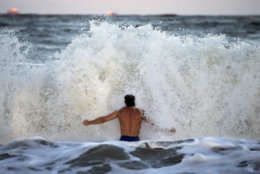 Body surfer Andrew Vanotteren, of Savannah, Ga., crashes into waves from Hurricane Florence, Wednesday, Sept., 12, 2018, on the south beach of Tybee Island, Ga. Vanotteren and his friend Bailey Gaddis said the waves have gotten bigger and better every evening as the storm approaches. (AP Photo/Stephen B. Morton)