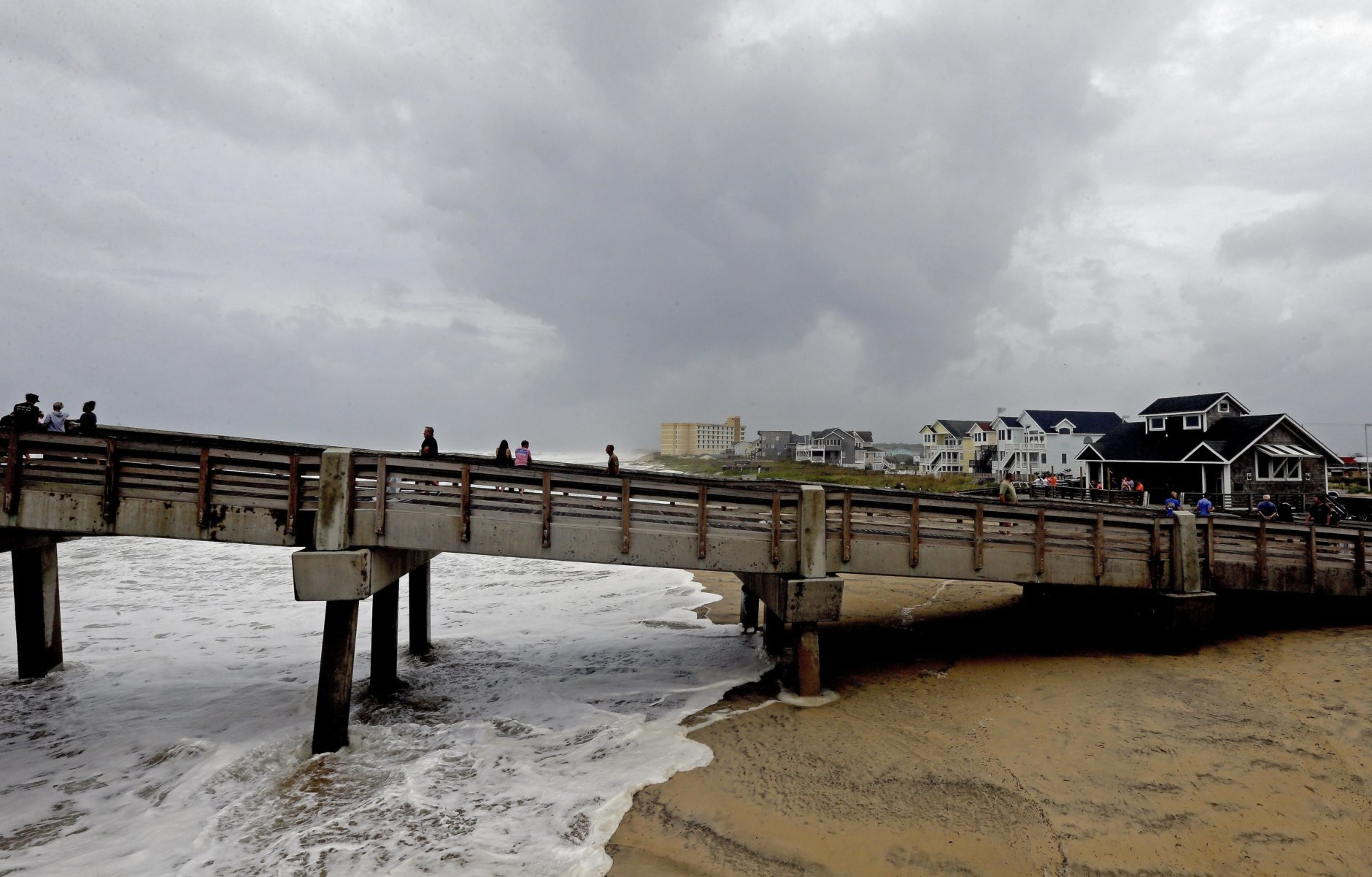 Heavy surf washes under Jennette's Pier in Nags Head, N.C., Thursday, Sept. 13, 2018 as Hurricane Florence approaches the east coast. (AP Photo/Gerry Broome)
