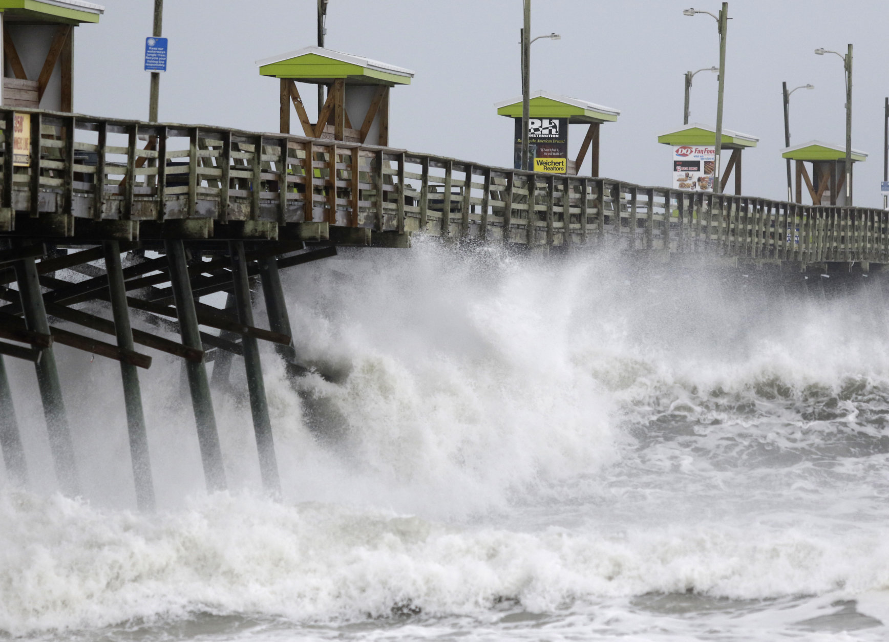 Waves from Hurricane Florence pound the Bogue Inlet Pier in Emerald Isle N.C., Thursday, Sept. 13, 2018. (AP Photo/Tom Copeland)
