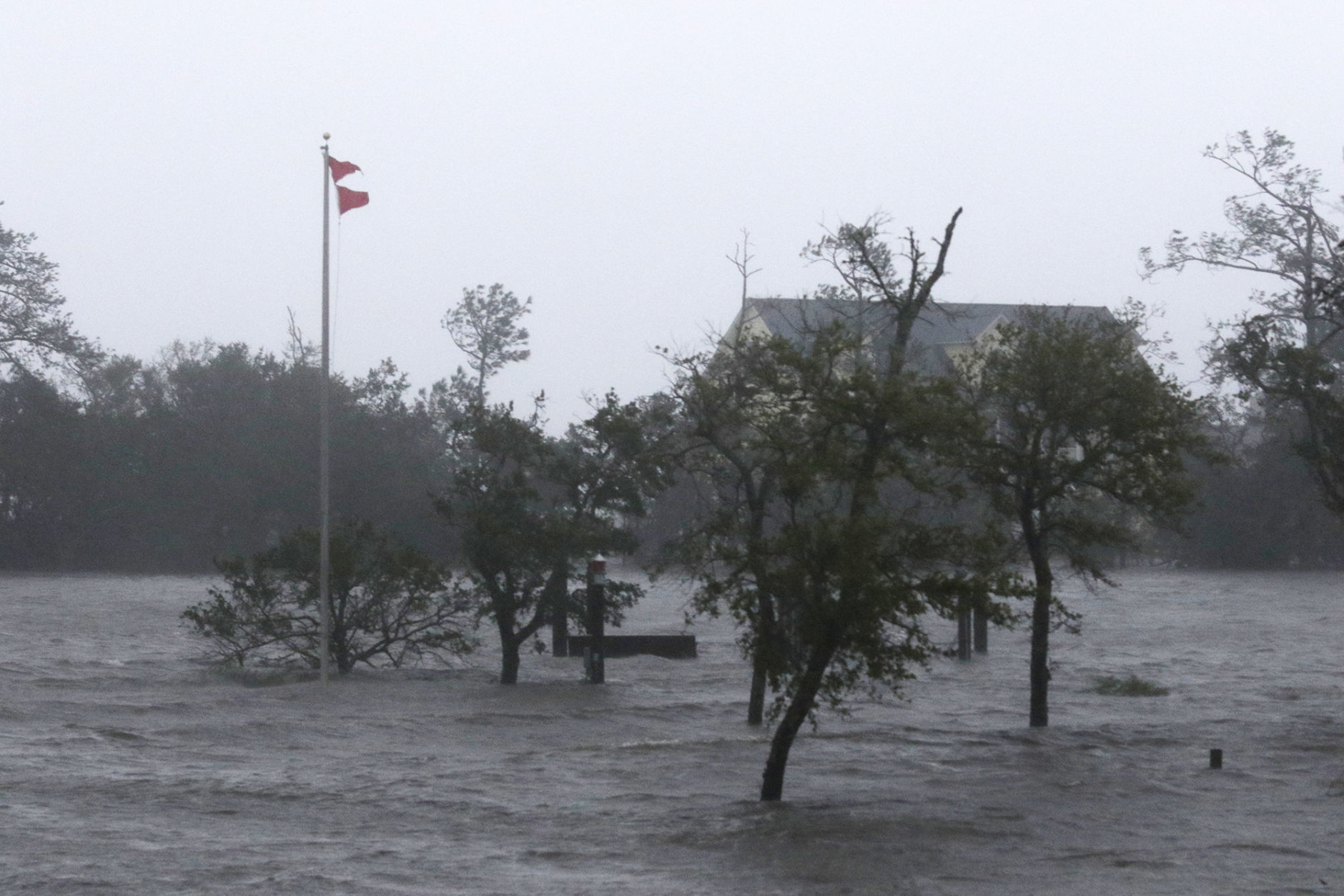 High winds and storm surge from Hurricane Florence hits Swansboro N.C.,Friday, Sept. 14, 2018. (AP Photo/Tom Copeland)