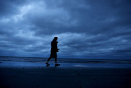 """Russ Lewis looks for shells along the beach as Hurricane Florence approaches Myrtle Beach, S.C., Friday, Sept. 14, 2018. """"I woke up this morning and couldn't hear the ocean. It's kind of spooky,"""" said Lewis. """"You don't expect to see the ocean this calm."""" (AP Photo/David Goldman)"""