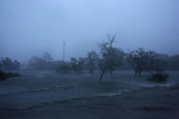 Before sunrise, high winds and storm surge from Hurricane Florence hits Swansboro N.C.,Friday, Sept. 14, 2018. (AP Photo/Tom Copeland)